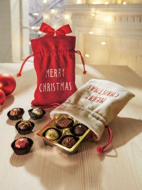Stoffbeutel mit der Aufschrift Merry Christmas. Ohne Füllung, Maße: ca. 15 x 20 cm, Material: Polyester.<br>