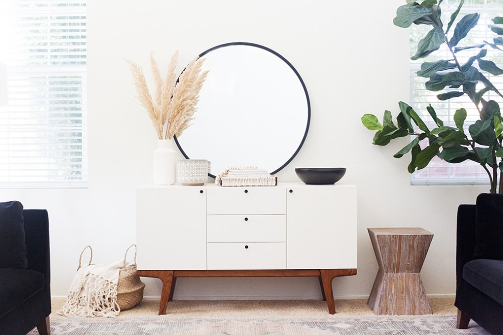Vintage Chic Decor with Walmart by popular life and style blog, E. Interiors: image of a Walmart Urban Trends Collection: Ceramic Vase Coated Finish White with pompas grass in it, Safavieh Natak Nautical Straight Curved Oak Side Table, and a Walmart 3R Studios Grey and White Stoneware Planters.