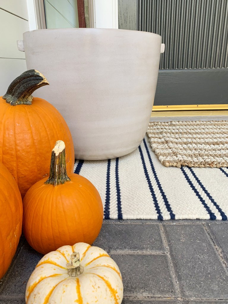 ANNIE SELKE RUGS by popular interior design blog, E. Interiors: image of a front porch with layered Annie Selke Rugs.
