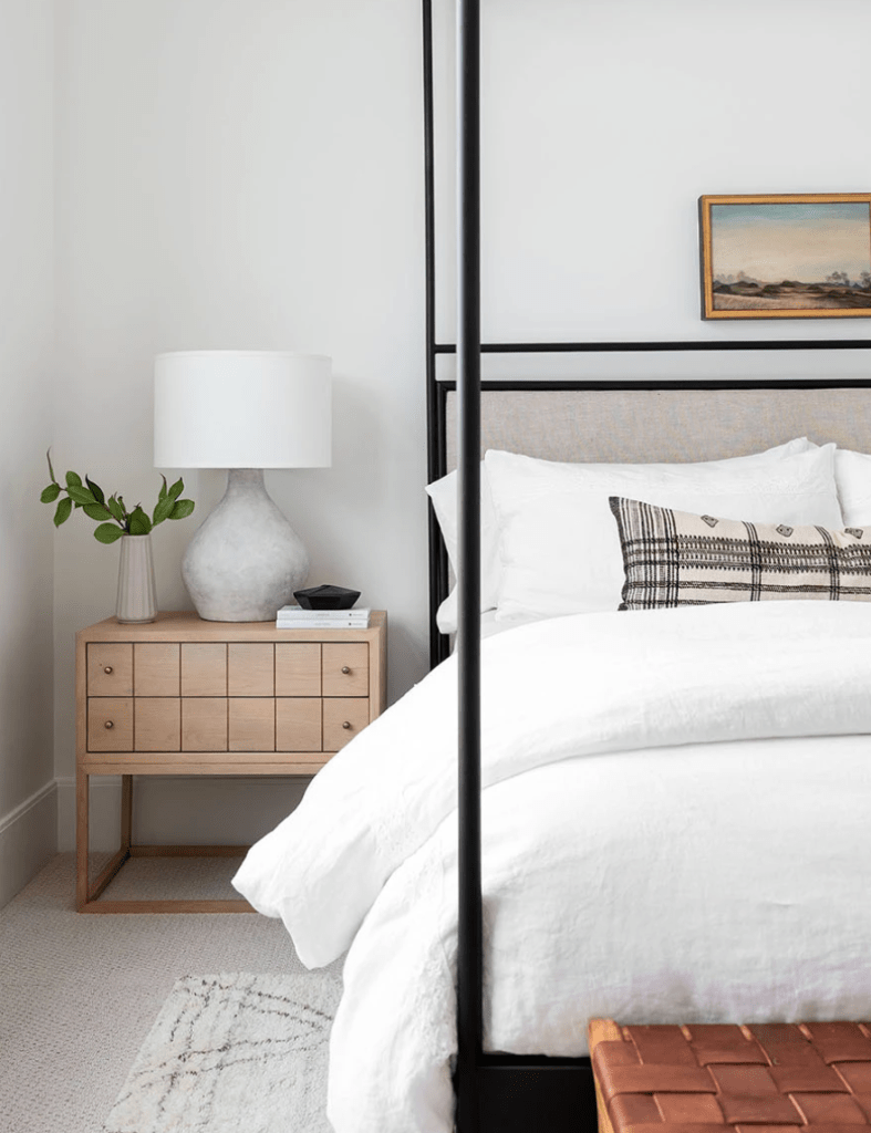 Unique Nightstands by popular US interior design blog, E. Interiors Design: image of a bedroom with a light wood nightstand.