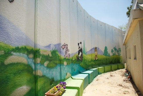 Protection around a kindergarden in the Nahal Oz Kibbutz. It was painted by the community to make it less intimidating for the children.