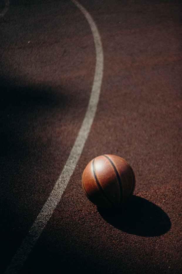 brown basketball on basketball court