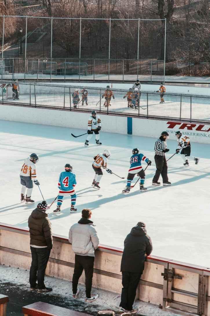 players playing ice hockey