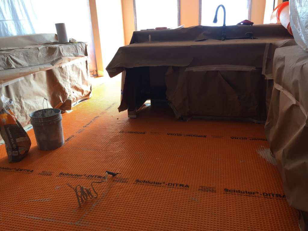 Kitchen tile replacement with Schluter-Ditra system.