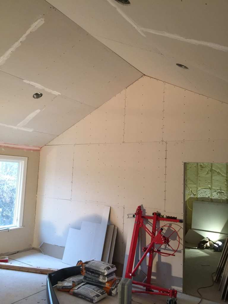 Master bedroom remodeled with raised ceiling, paint, and lighting.