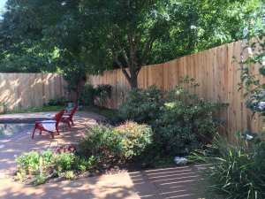 Installation of new 10-foot cedar fence.