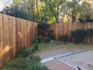 Installation of 10-foot high cedar fence and seal.