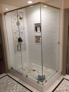 New shower and floor tile, new shower door glass.