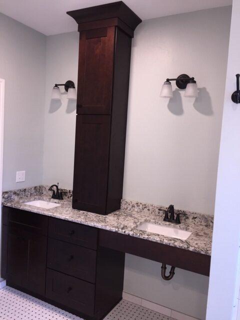 Vanity, Granite, Vanity Lights, Sinks, and Tile Floors.