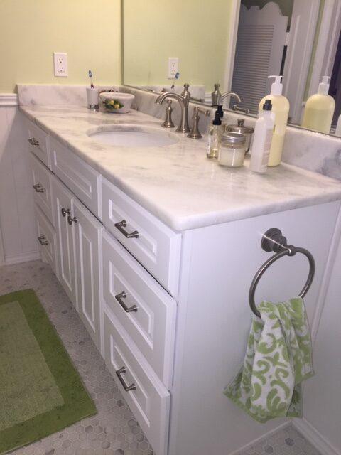 Vanity, Granite, Tile Floor, and Paint.