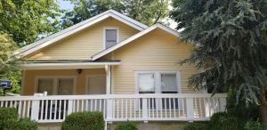 Wood repair and new exterior paint on classic home