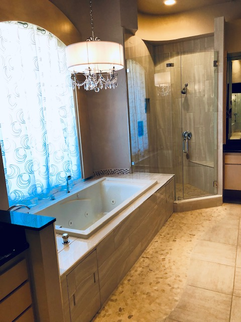 Beautiful - New shower and flowing floor tile, new shower glass, new stand-alone tub with new surrounding frame and tile, new chandelier.