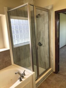 Complete shower remodel with new tile, framed shower glass and the Schluter system.
