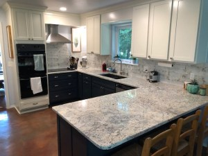 This kitchen remodel includes new upper and lower cabinets (two colors), hood and granite.
