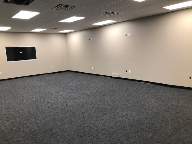 This commercial remodel includes new interior texture and paint, new carpet, new drop-down ceiling, new windows, and door.