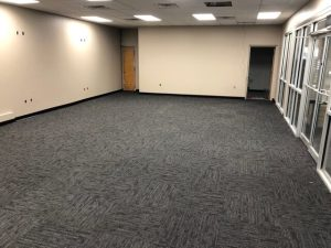 This commercial remodel includes new drywall, texture, paint, carpet, and ceiling grid.