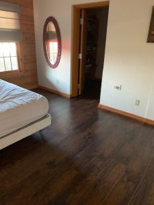 This room was remodeled with new engineered wood flooring.