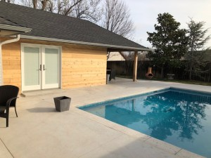 New custom colored concrete. New wood siding. New French door. New outdoor patio.