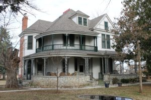 An 1890's bed and bath remodeled with new siding, exterior paint, patio flooring repairs, and new roof.