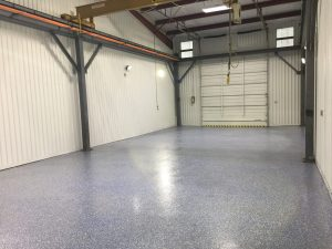 Custom commercial floor with epoxy coating and multi-colored flecks.
