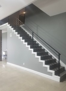 New custom metal stair rail in new construction garage.