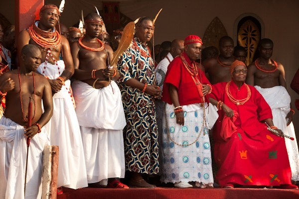 The Oba (King) of the Benin Royal Kingdom in Nigeria is seated beside his Chief Priest, (to his left) and his royal attendants, at the annual Igue Ceremony celebrating the power of the ancient kingdom and reaffirming its well-being and prosperity. 2010 Oba of the Kingdom of Benin