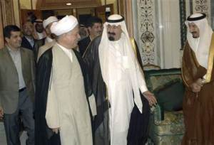 Saudi King Abdullah second right and Iranian politician Akbar Hashemi Rafsanjani chat at Wednesdays interfaith dialogue in Mecca