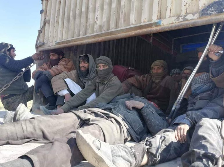 ISIS militants surrendering to Kurdish fighters in Baghous, Syria.