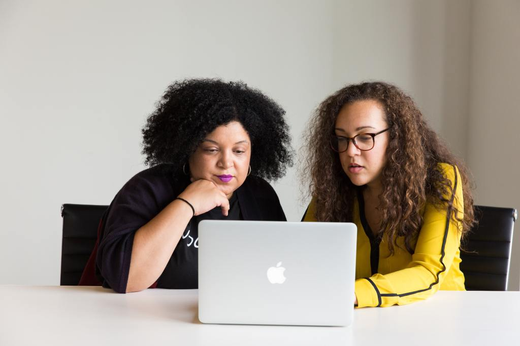 event planning internship - photo of two women sitting at a laptop