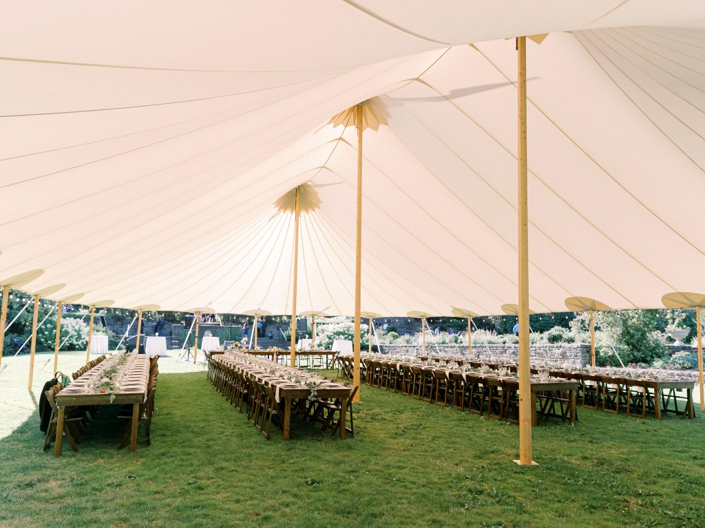 long tables underneath a wedding tent wedding marquee