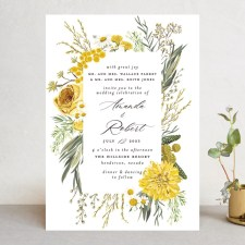 a wedding invitation with a floral motif