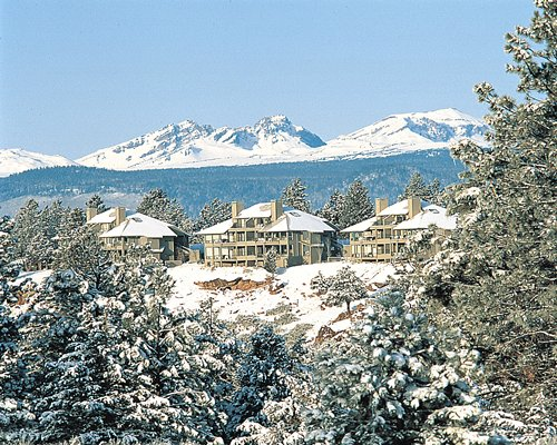 Vista view of Mt Bachelor Village Resort showing snow-capped mountains in the distance
