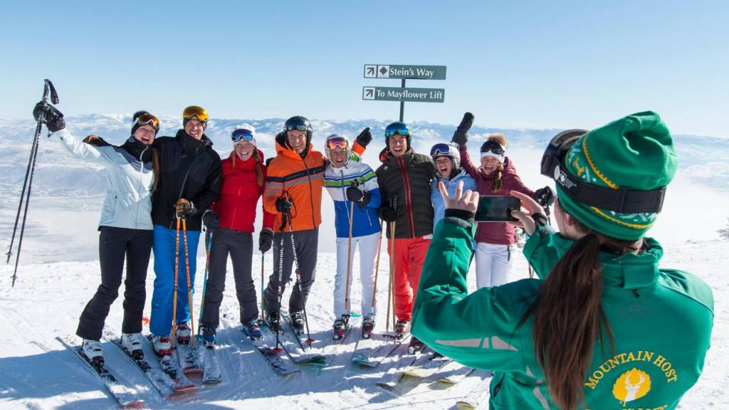 A group of skiers smiling at Deer Valley Resort - Group Travel