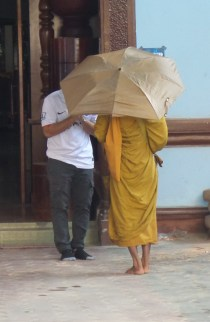 Monk receiving daily alms