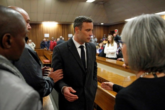 Olympic and Paralympic track star Oscar Pistorius leaves the court after his sentence hearing at the North Gauteng High Court in Pretoria, South Africa, July 6, 2016. REUTERS/Marco Longari/Pool