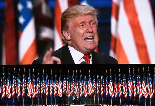 US Republican presidential candidate Donald Trump speaks on the last day of the Republican National Convention on July 21, 2016, in Cleveland, Ohio. / AFP PHOTO / JIM WATSON