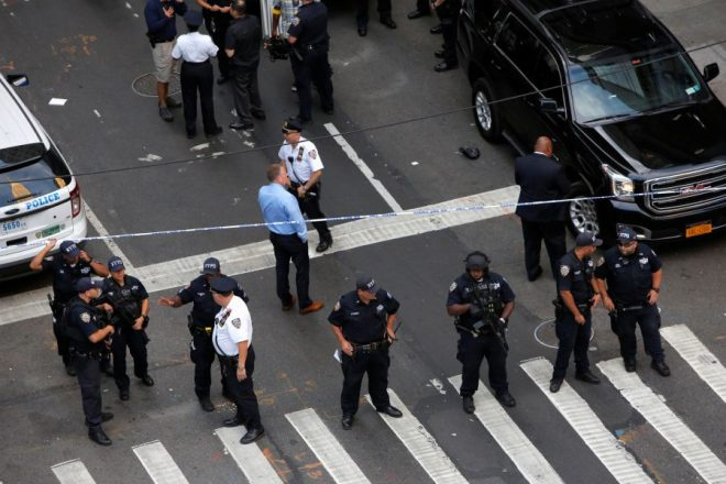 Police investigate the scene where a man was shot by police in Manhattan, New York, U.S., September 15, 2016. REUTERS/Andrew Kelly