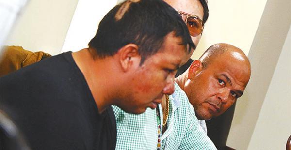 Elías Barba Galarza y el colombiano Nelson Yadir en plena audiencia