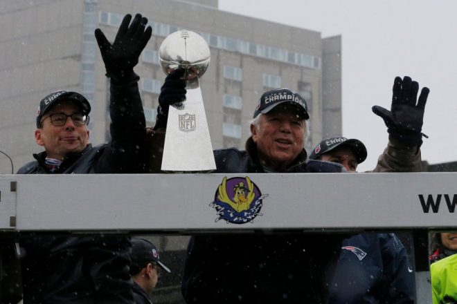 New England Patriots owner Bob Kraft holds one of the team
