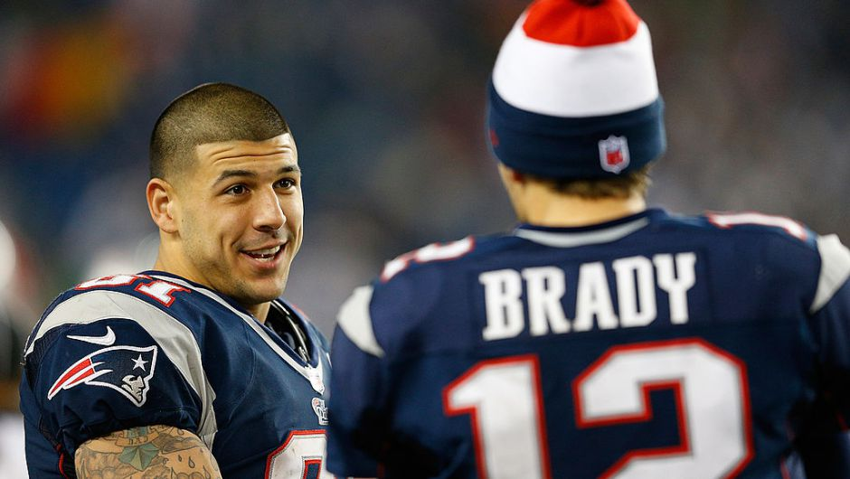 FOXBORO, MA - DECEMBER 10: Tom Brady #12 of the New England Patriots chats with Aaron Hernandez #81 against the Houston Texans at Gillette Stadium on December 10, 2012 in Foxboro, Massachusetts. (Photo by Jim Rogash/Getty Images)