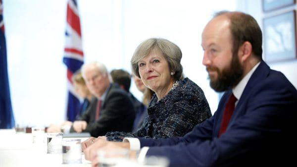 Timothy junto a May (Reuters)