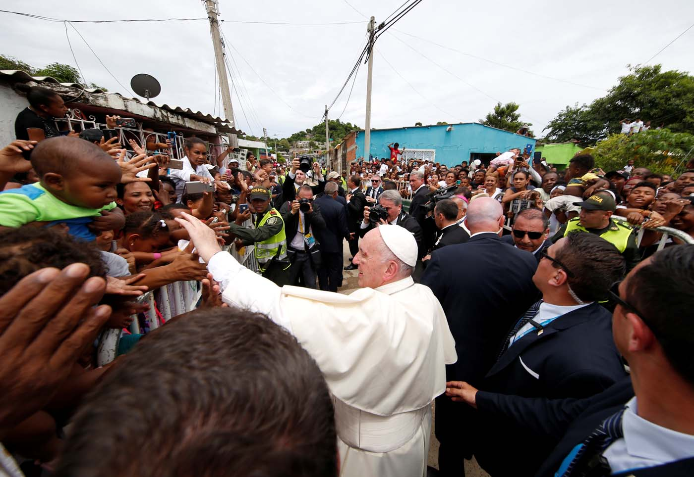 Pope Francis greets people in a neighbourhood in Cartagena, Colombia September 10, 2017. REUTERS/Stefano Rellandini