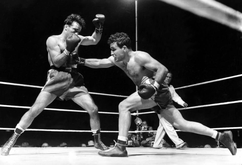 LaMotta (derecha), durante el combate contra Marcel Cerdan en el que ganó el título mundial de pesos medios, el 16 de junio de 1949.