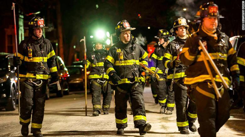 NEW YORK, NY - DECEMBER 28:Firefighters leave after putting out a major house fire on Prospect avenue on December 28, 2017 in the Bronx borough of New York City. Over 170 firefighters respond to the evening fire in which at least 12 persons were killed with others injured. (Photo by Amir Levy/Getty Images)