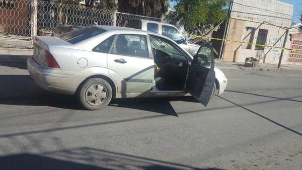 El automóvil de Carlos Domínguez Rodríguez después del ataque