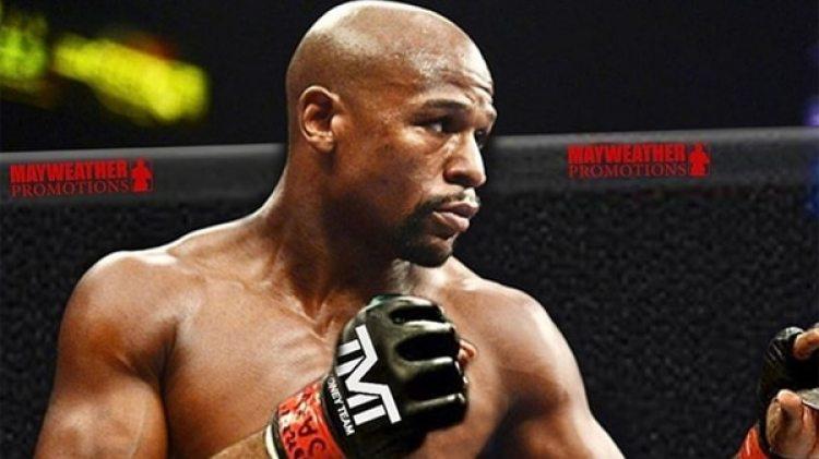 Mayweather estaría preparándose para pelear MMA con ayuda de Tyron Woodley, campeón de UFC