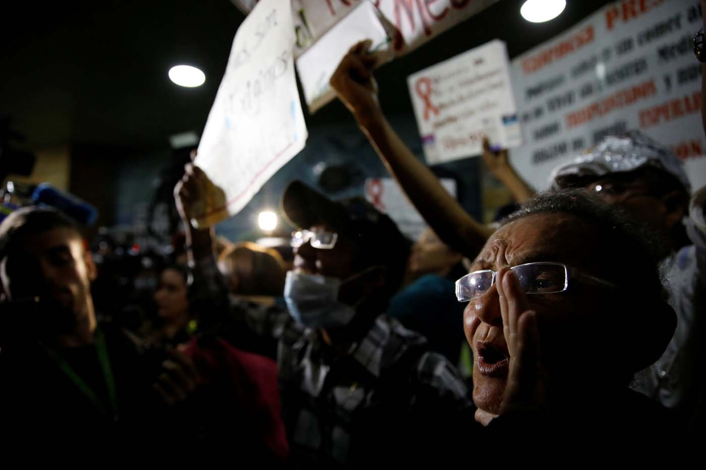 People shout slogans during a protest due to the shortages of medicines outside the Health Ministry in Caracas, Venezuela April 18, 2018. REUTERS/Carlos Garcia Rawlins