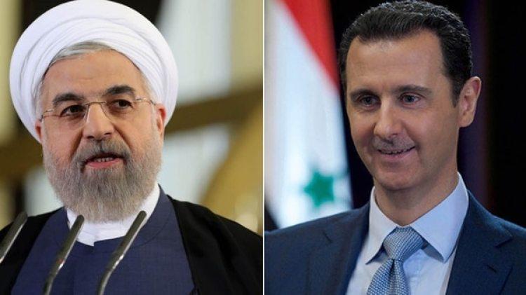 Hasan Rohani, presidente de Irán, y Bashar al Assad, dictador de Siria