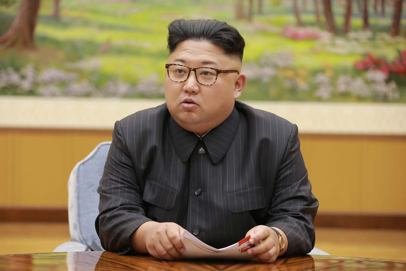 North Korean leader Kim Jong Un participates in a meeting with the Presidium of the Political Bureau of the Central Committee of the WorkersÕ Party of Korea in this undated photo released by North Korea