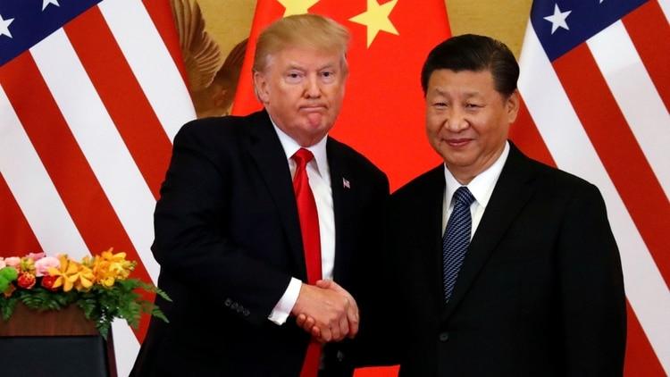 El presidente de los EEUU, Donald Trump, y su par chino, Xi Jinping; durante su cumbre en Beijing en noviembre de 2017